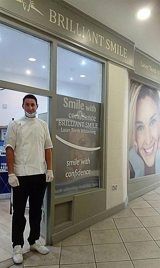 Roman in front of Brilliant Smile